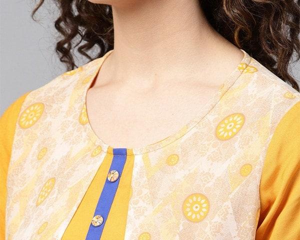 A mustard yellow, round neck kurta with circular flower prints.