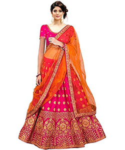 A model wearing a Lehenga choli set with a pink coloured blouse and along with a netted dupatta having golden designs on choli.