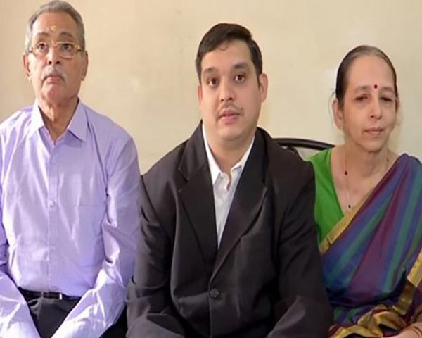 nikhil seated with parents on his sides