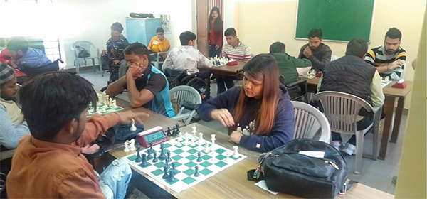 Participants in chess championship for physically disabled.