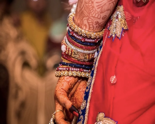 Indian bride with mehendi on her hand