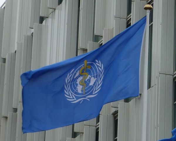 Flag of WHO with the logo of WHO (World Health Organization))