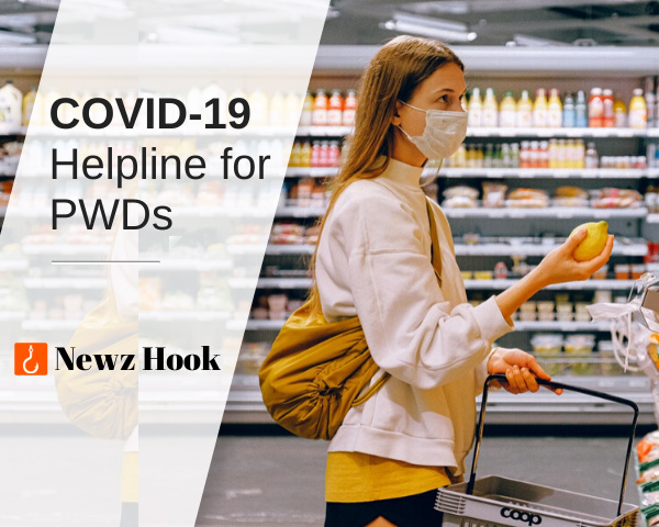 A woman covered with a face mask is seen holding a fruit in a general store - COVID-19 Helpline for PWDs - Newz Hook