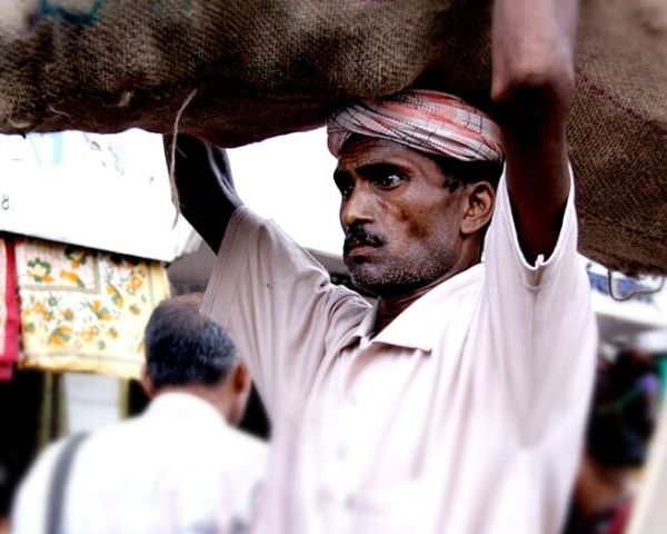 Labourer carrying a load on his head