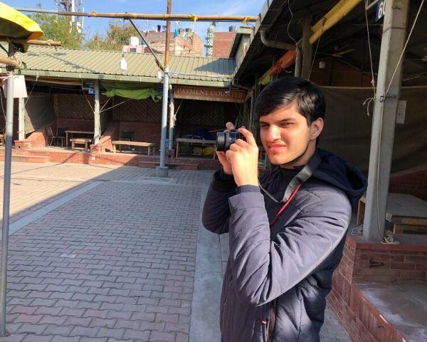 Pranav Bakshi holding a camera