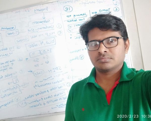 Yogesh Sonar is wearing a green Tshirt and standing before a whiteboard