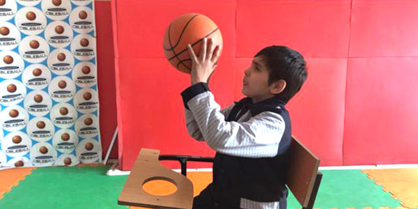 A young boy playing cibleball.