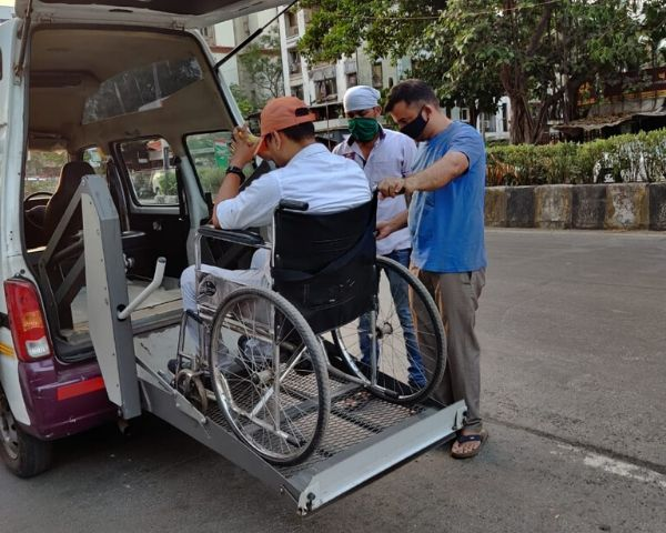 Person in wheelchair using EzyMov transport