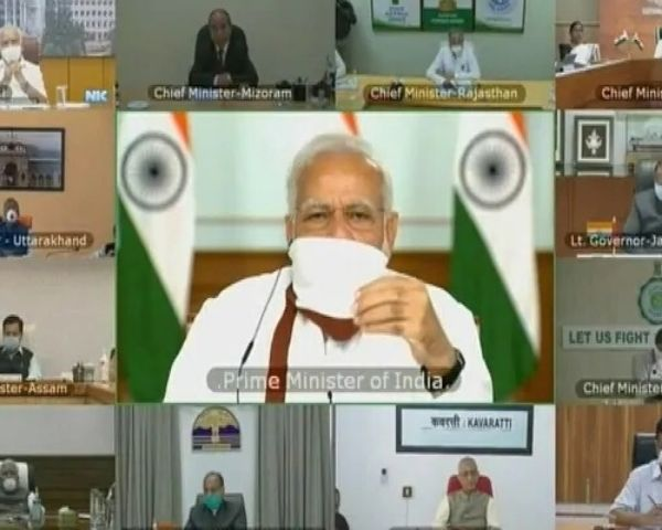PM Modi holding a video conference