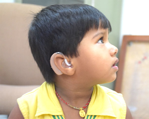Close view of a young student at Suniye school with a hearing aid in the ear.