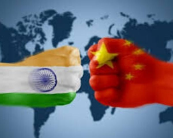 India and China flags enclosed in a fist