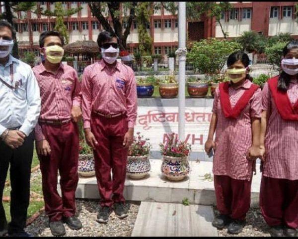 3 male, 2 female NIEPVD employees wearing Nayan masks