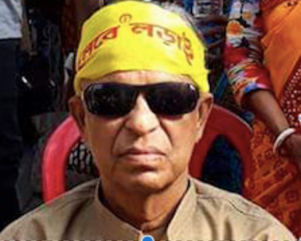 Sailen Chowdhury wearing dark glasses and a yellow bandanna
