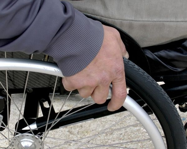 Hand of a person on a wheelchair