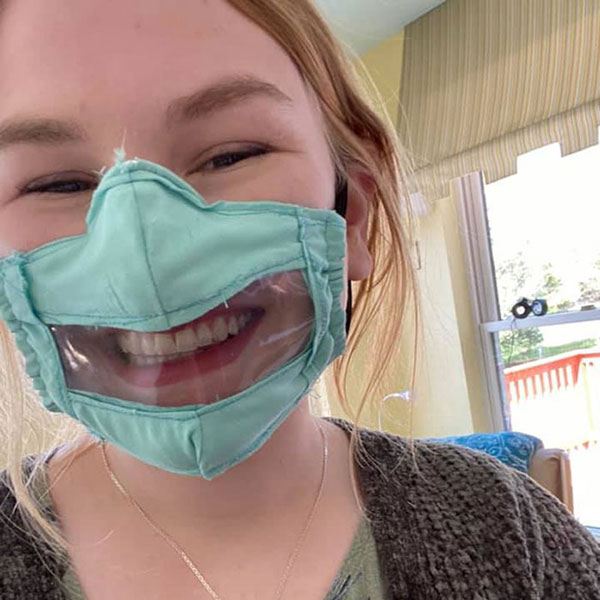 College student Ashley wearing the mask she designed with a transparent plastic on the mouth.
