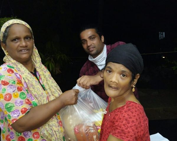 giving grocery kits to disabled
