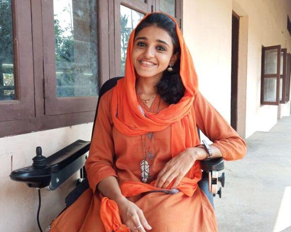 fathima asla sitting on wheelchair
