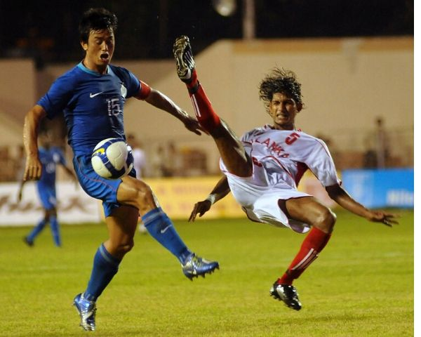 Former Indian footballer Bhaichung Bhutia playing
