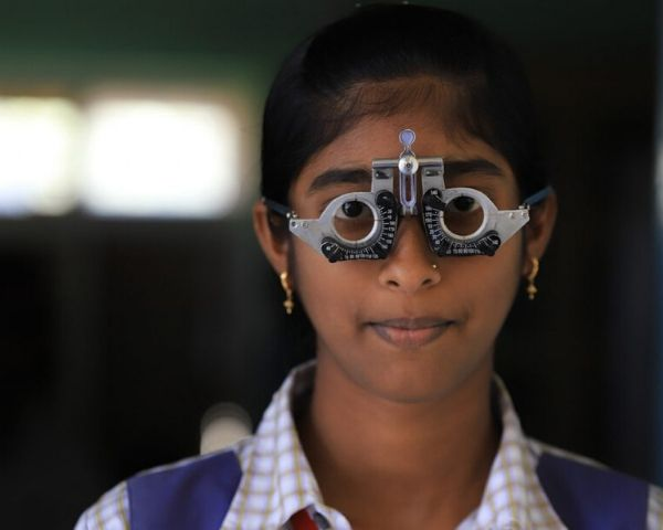 Young girl getting her eyes tested