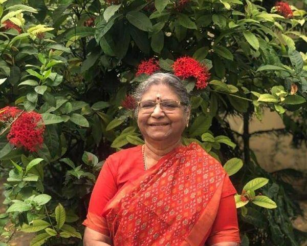 Saraswathi Narayanaswamy wearing a printed red saree