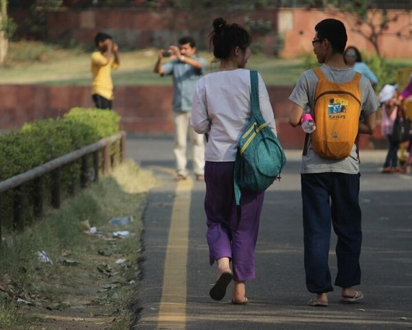 2 students with backpacks walking