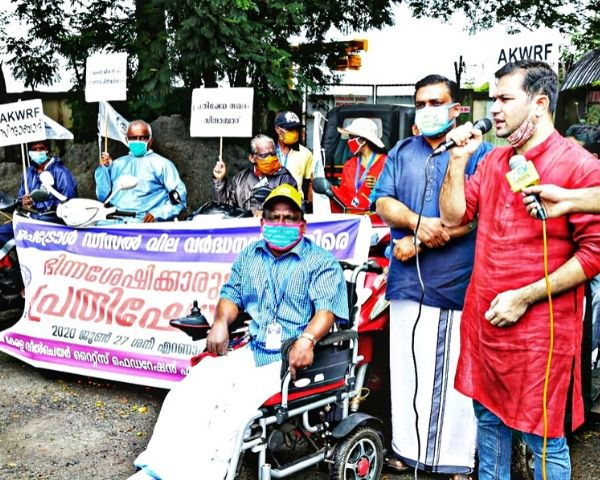 people protesting on wheelchair
