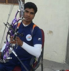 Satendr Mirey is sitting with his archery equipment