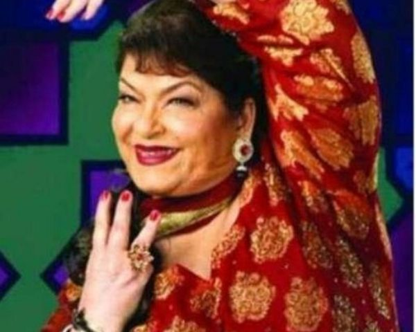 Saroj Khan is striking a dance pose