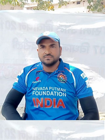 Sanjeev Singh Rajpoot is wearing the Indian cricket gear.