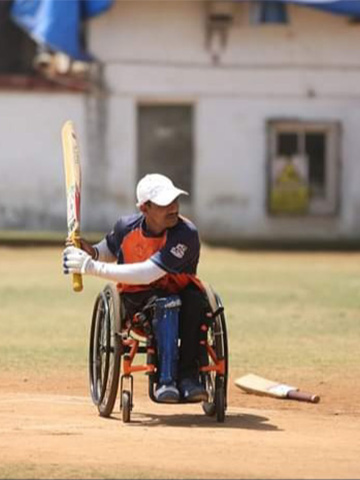 Santosh Ranjane batting on the field.