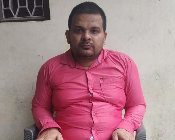 Abdul Qadir who has a 80% locomotor disability is wearing a pink shirt