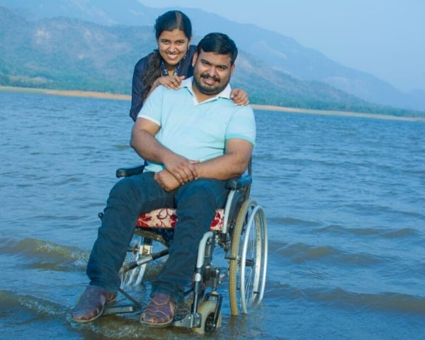 man on wheelchair with wife