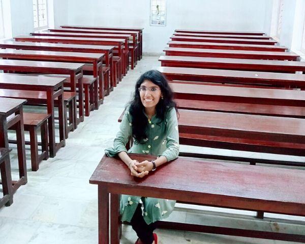girl sitting inside classroom