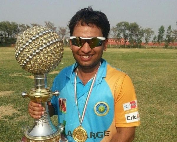 Vijay Kant Tiwari is holding the T20 series trophy