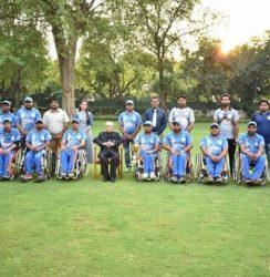Wheelchair cricket team with former president Pranab Mukherjee