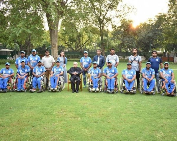 Wheelchair cricket team with former president Pranab Mukherjee