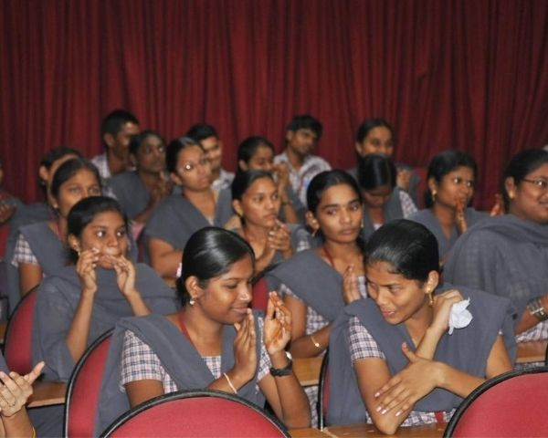 Group of visually impaired girls seated together