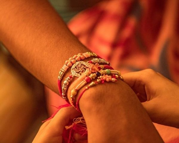 sister tying rakhi for brother