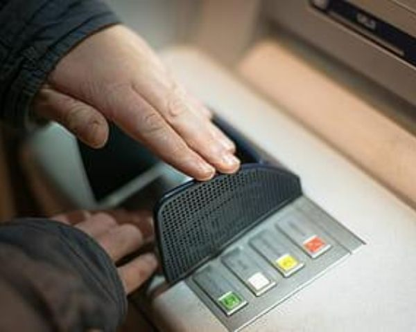 hand on the atm machine