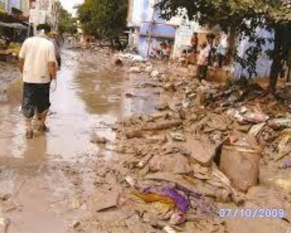 Flooded streets with bricks and other dbris