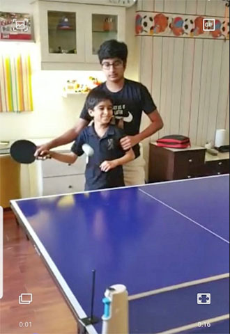 Jai and Vir Gupta playing table tennis.