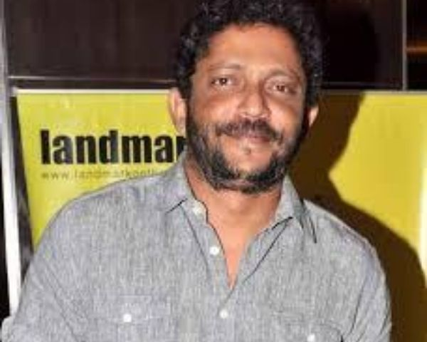 Nishikant Kamat is wearing a grey shirt