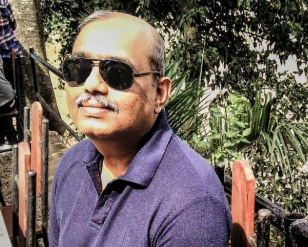 Harish Kotian is wearing a dark blue Tshirt