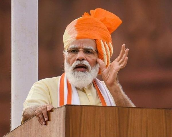 Pm modi wearing a saffron turban