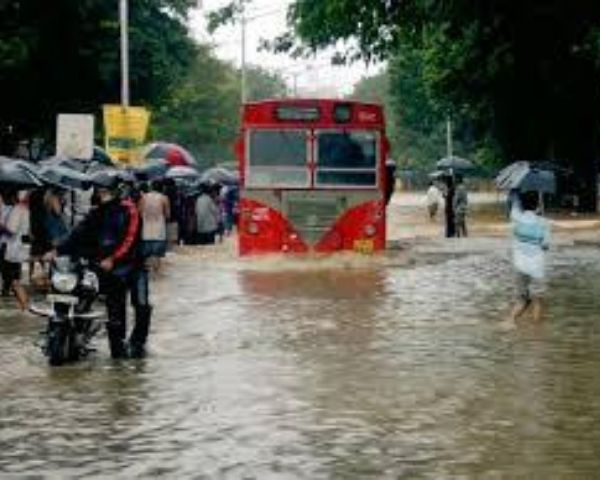 Red coloured bus stuck in heavy rains