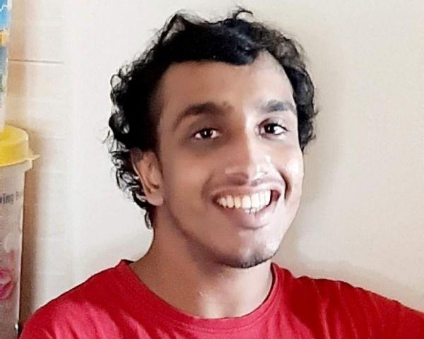 Nikhil Saiprasad is wearing a red T shirt