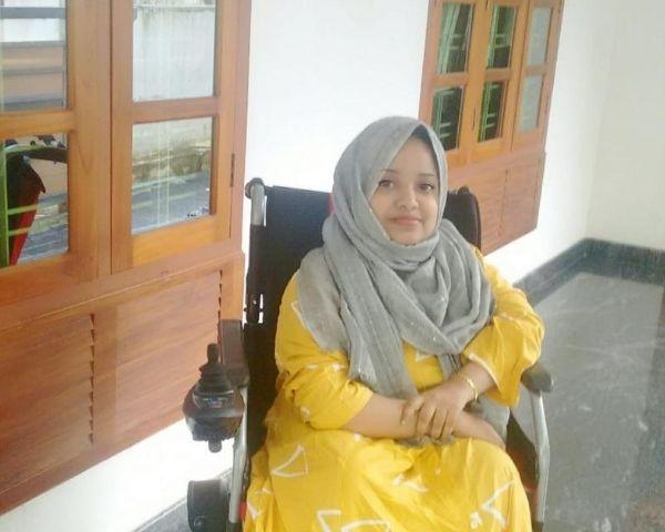 shibina on a wheelchair