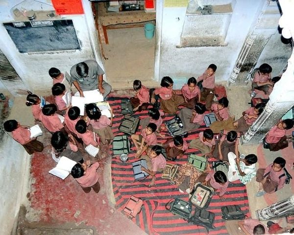 Group of students sitting on the floor