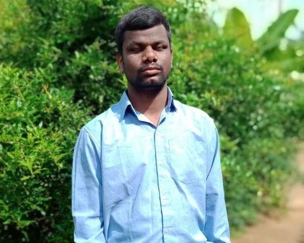 Veeresh M, visually impaired KPSC aspirant, is wearing a blue shirt