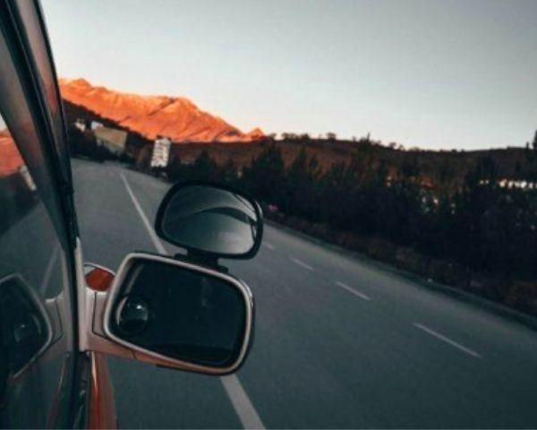 Clipped convex mirror on a car window help build better visual sense